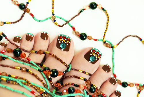 Nice pedicure with rhinestones embellishment from beads