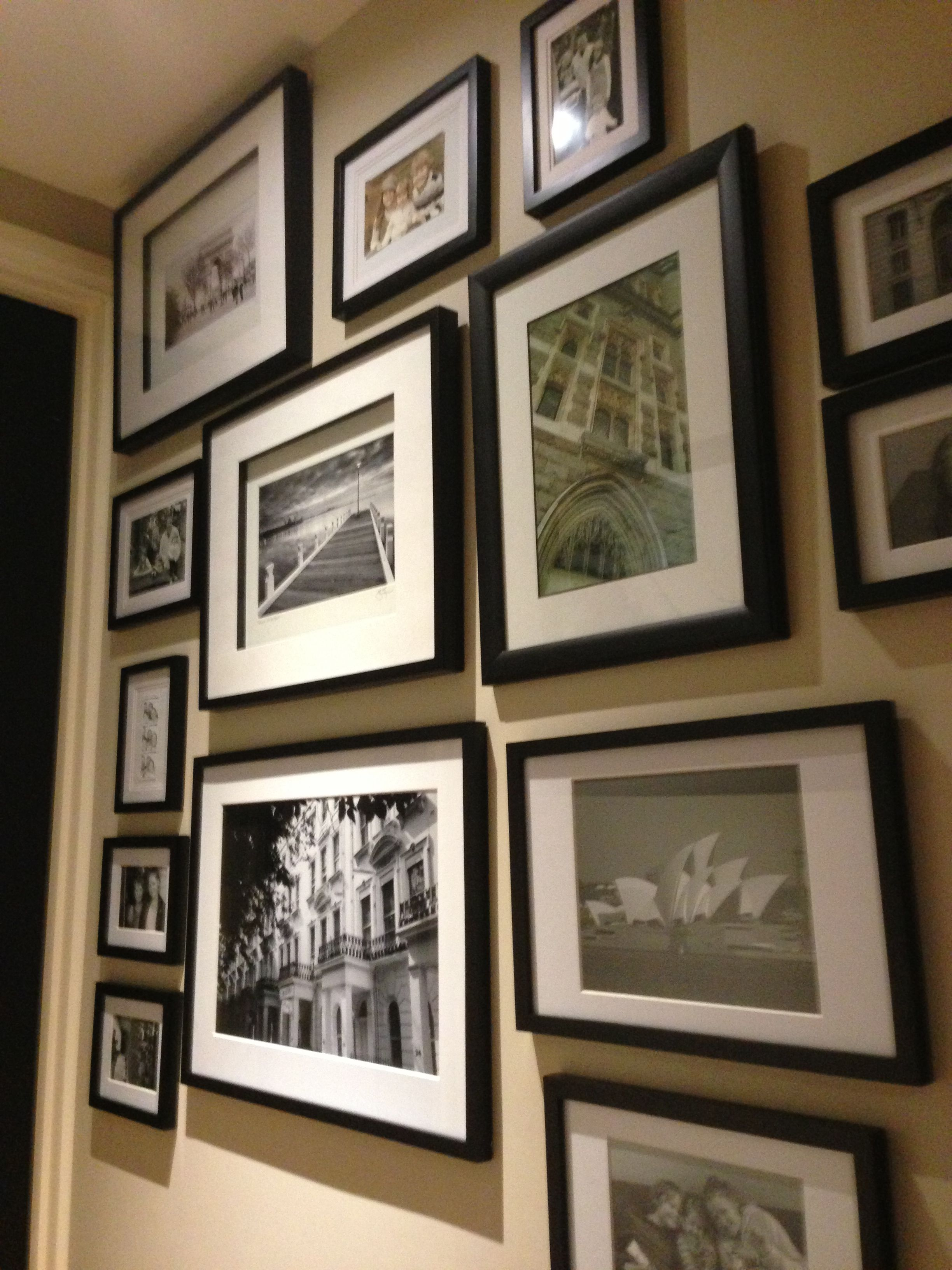 I love to mix  photos of the family with travel photos of places we have been. This is a hallway in our home that I love. I have used all black frames but different sizes.