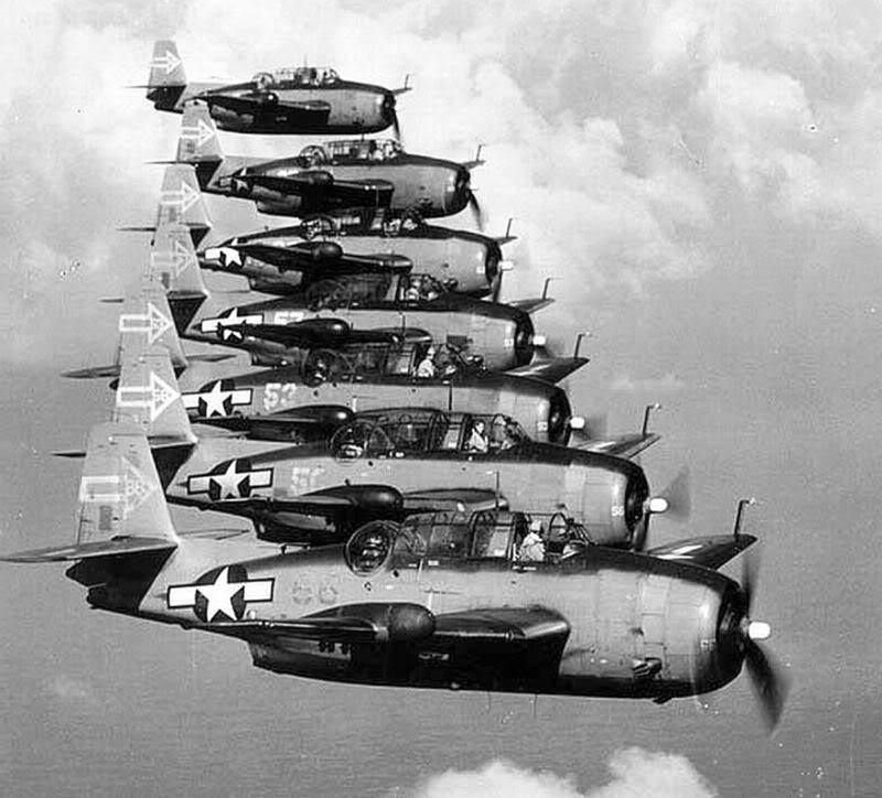 Seven TBM-3D Avengers (modified for night action) of VT(N)-90 fly from the carrier USS Enterprise in the western Pacific, January 1945. (Photo: William T. Barr, photographers mate, USN)