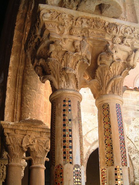 Double column capital with jousting knights