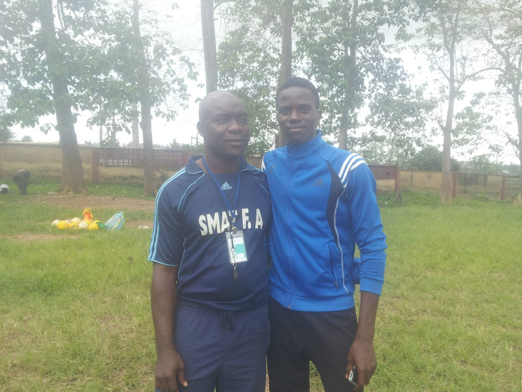 coach onagoruwa poses with one of the players