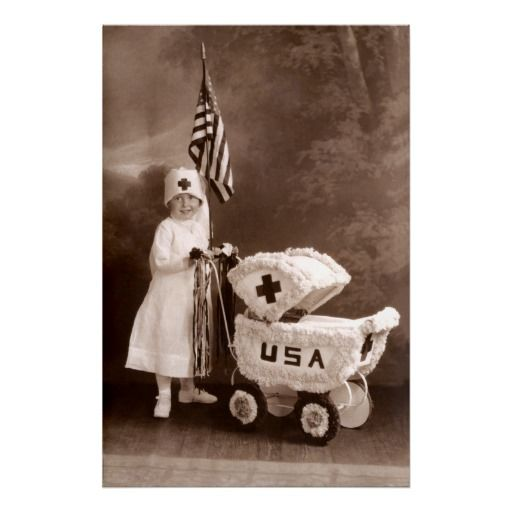 1917 WWI era smiling young girl dressed as a patriotic Red Cross Nurse.