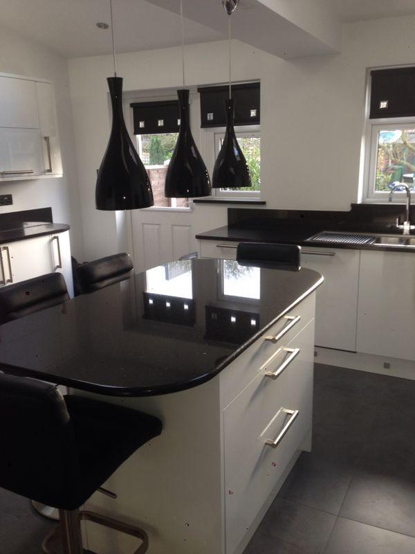 Black Nero Assoluto Granite worktops on contemporary white kitchen ...