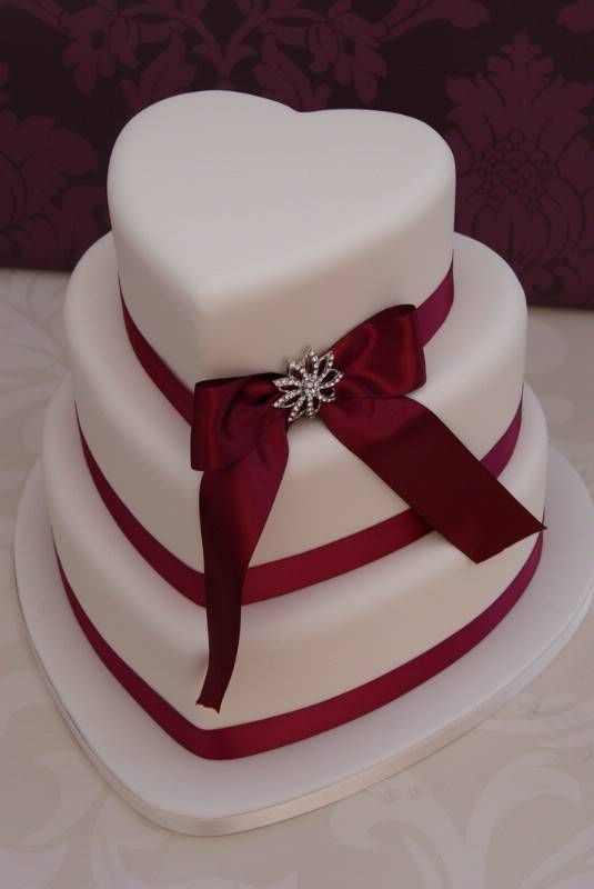 Heart Shaped Wedding Cake Beautiful Decorated With A Bow And