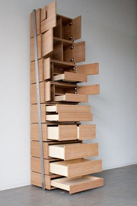 """Staircase by Danny Kuo is a fun and innovative piece of hybrid furniture. It combines the concept of bookshelf with a pull out staircase for the bottom three shelves."""