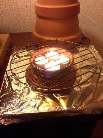 faire un petit chauffage d 39 appoint avec des bougies pots. Black Bedroom Furniture Sets. Home Design Ideas