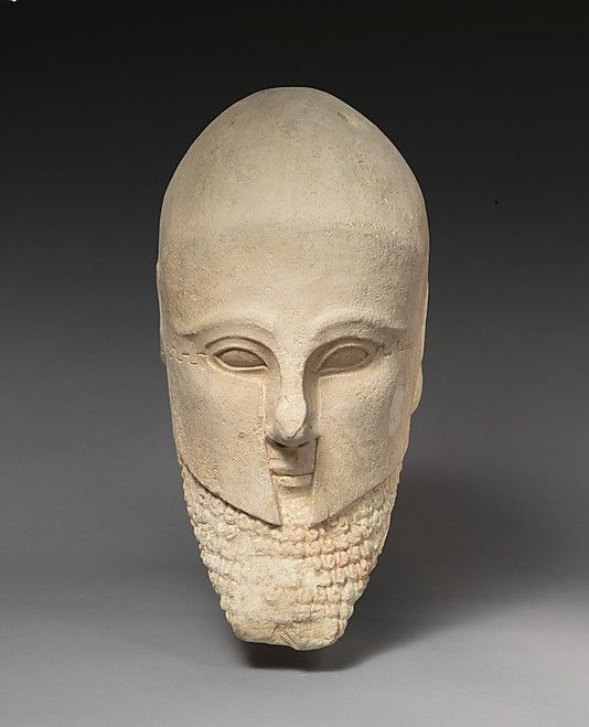 Limestone bearded head with a Corinthian helmet  Period:     Cypro-Archaic II Date:     early 5th century B.C. Culture:     Cypriot