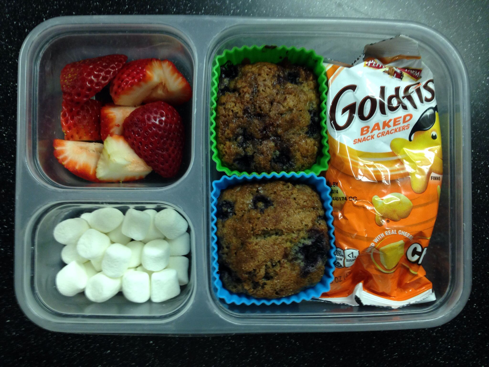 Blueberry oat muffins, goldfish crackers, strawberries and mini marshmallows :)