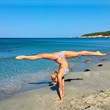🐒 Feeling amazing after my beach yoga session! ❤️ Bikini from @mer_culture_swimwear ❤️ #yoga #beachyoga #splits #handstand #namste #beachlife #mediterranean