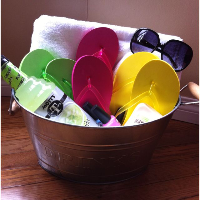 Summer gift basket. Towel, flip flops , sunscreen, sunglasses, nail polish, and margarita mix.