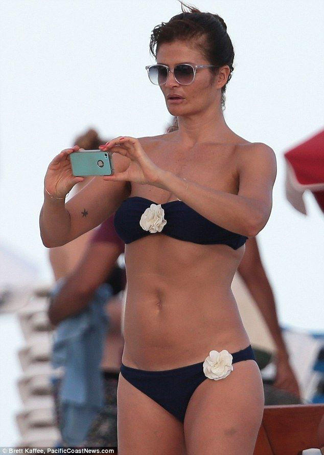 Helena Christensen shows off her enviable figure in a bandeau bikini ... bd0d453f5911f