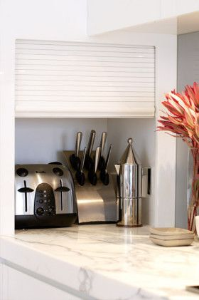 The Roller Door Cupboard At The End Of The Bench Is Discreet And Accessible Place To Store Popular Staples And Living Room Blinds Diy Blinds Diy Window Blinds