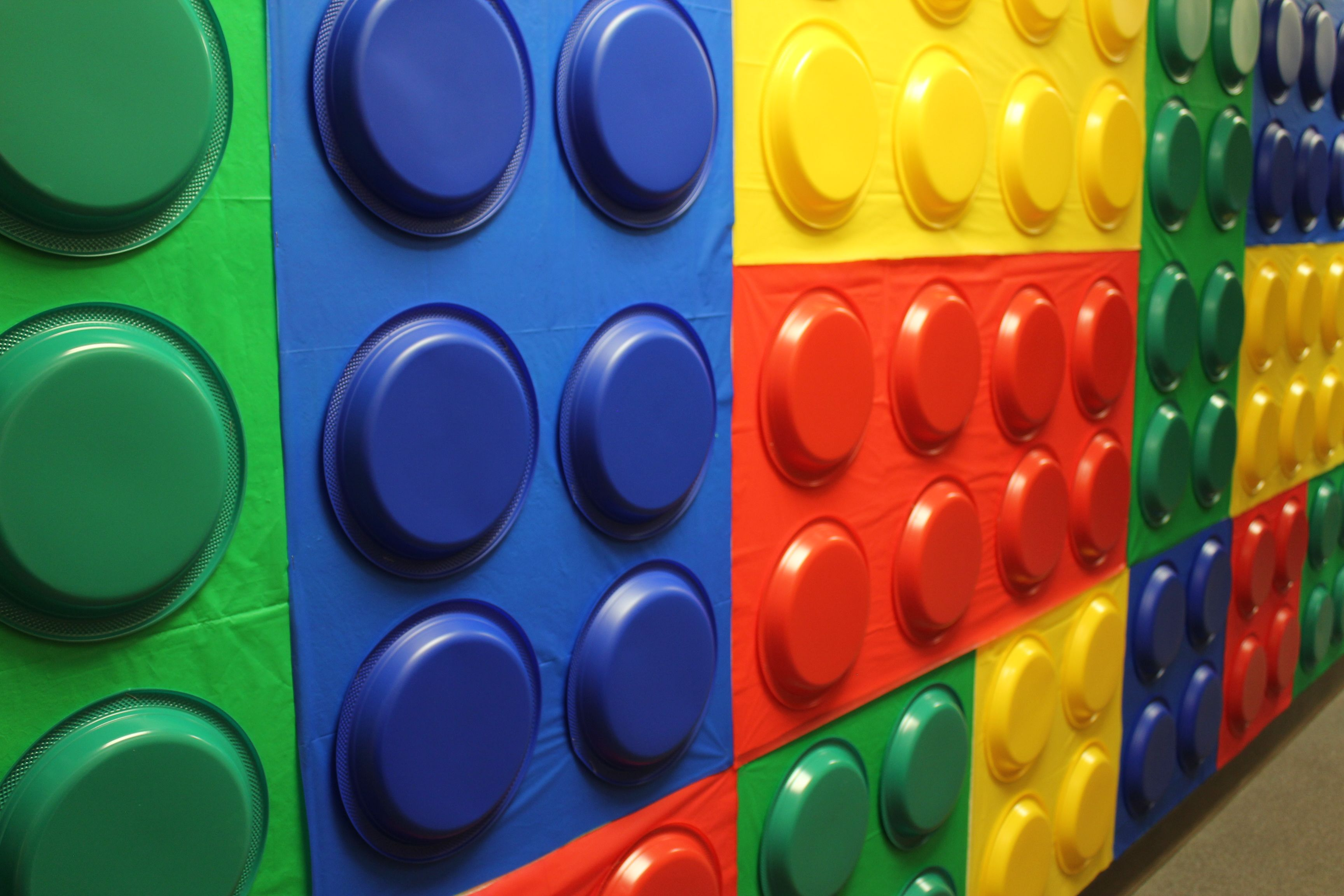 Lego Wall Using Plastic Table Clothes And Plastic Dinner Plates Lego Decorations Lego Classroom Theme Lego Wall