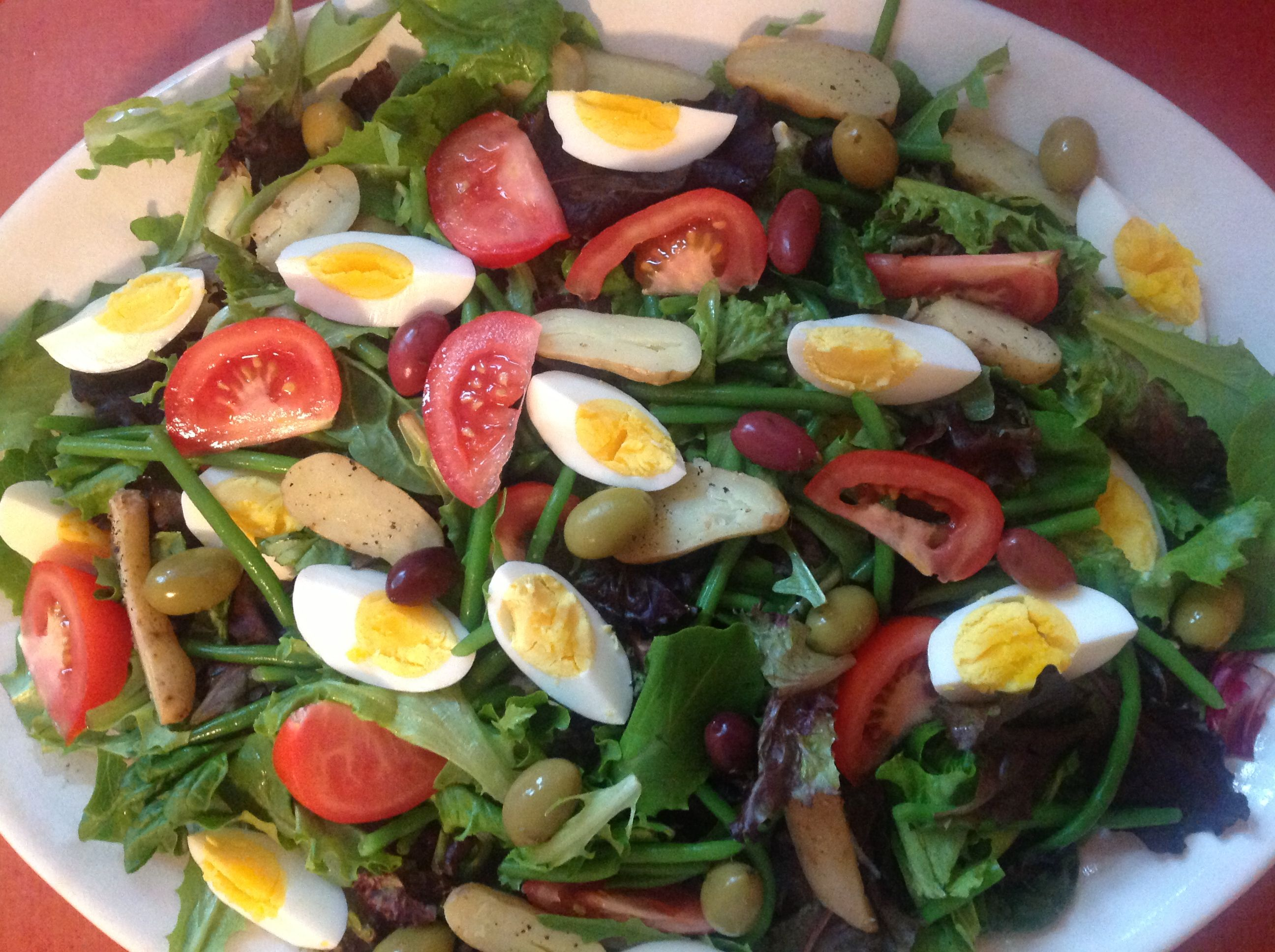 Salad Niçoise: fingerling potatoes, blanched haricot vert, hard boiled eggs, olives, mixed greens, tomatoes.