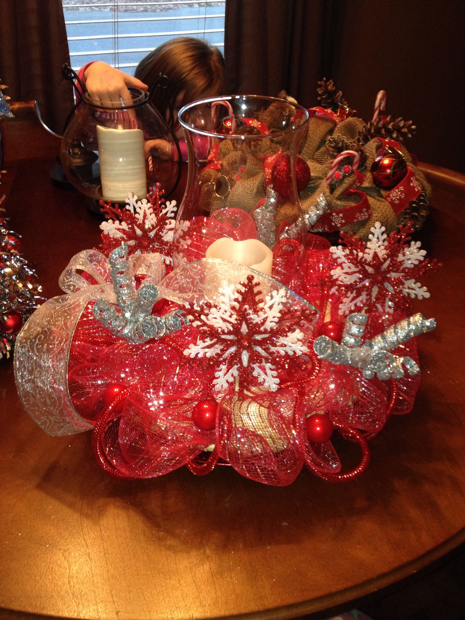 Christmas centerpiece. I use a straw round wreath and ...