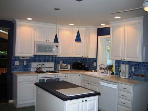 Blue Glass Tiles Backsplash With White Cabinets Similar Layout As Ours But Very Different Colors
