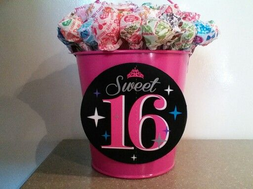 Dum dum lollipops put in a bucket for a Sweet 16th party. I glued the 16 on both sides. I will hang balloons on the handle of the bucket. Cost was about $5.25  I bought the lollipops from Sam's Club. Cuter than using weights i think.