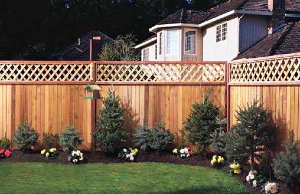 the landscaping along this fence makes the whole property look better - Garden Ideas Along Fence