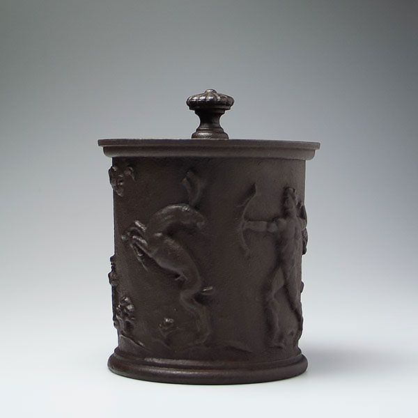 C Elmberg. Näfveqvarn. Cast iron tobacco jar with relief hunting scenery. Carl Elmberg for Näfveqvarns Bruk, 1920's.