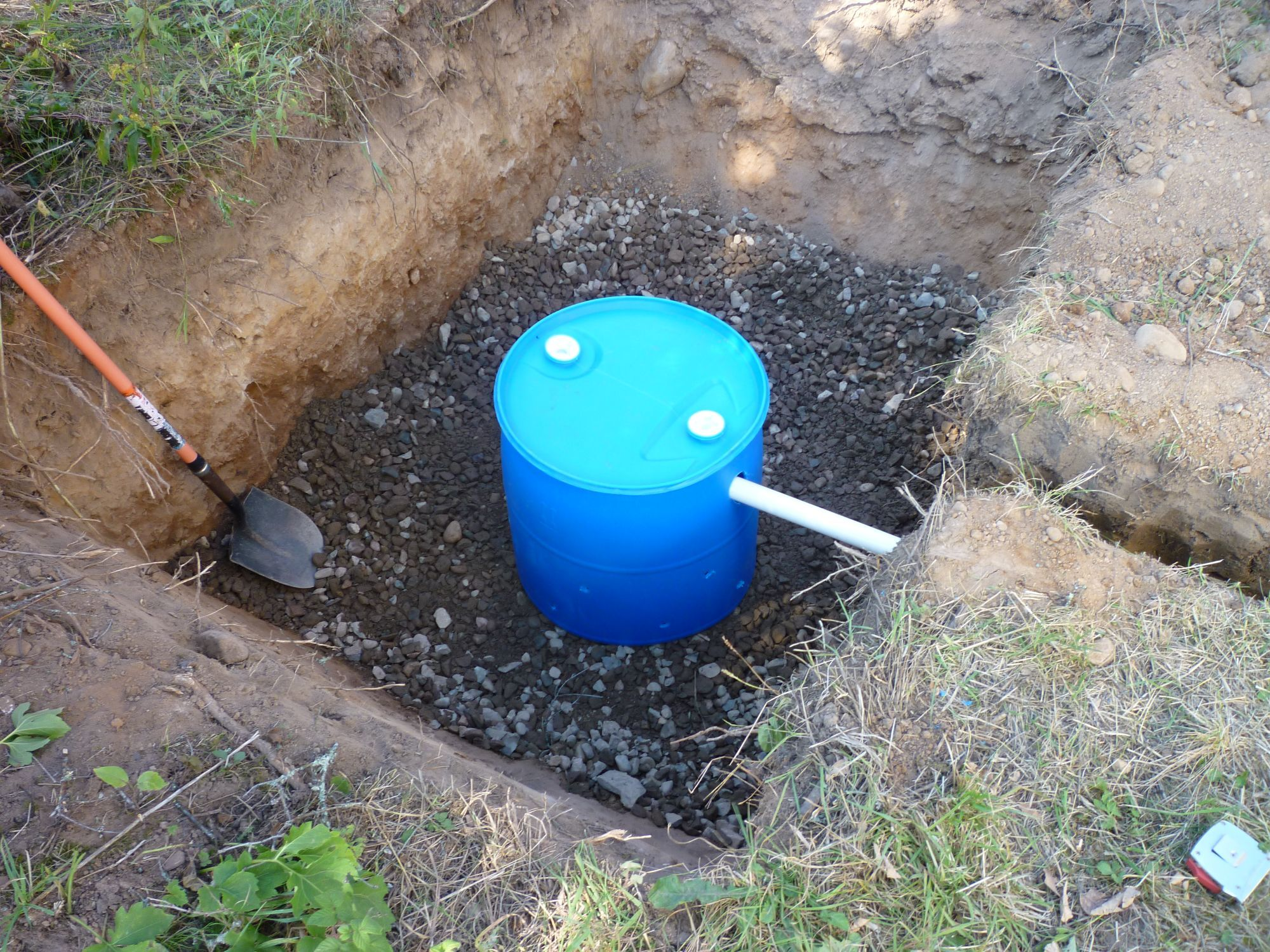 Make your own gray water dry well 55 gallon drum read more for Cabin septic systems