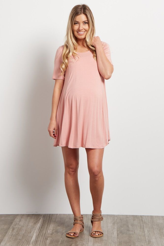 146e9a75aef42 We love this soft maternity tunic so much, we want it in every color! A  solid tunic with short sleeves and a lace-up back for a feminine detail.
