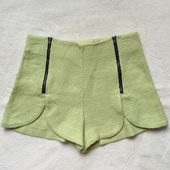 "Mint shorts Textured mint shorts with double zipper design in front which also serves as closure, scalloped hem. Measurement- waist - 13 1/2 "" , length- 12"", inseam- 3"". Item measured laying flat on the ground. Gently worn. Shorts"