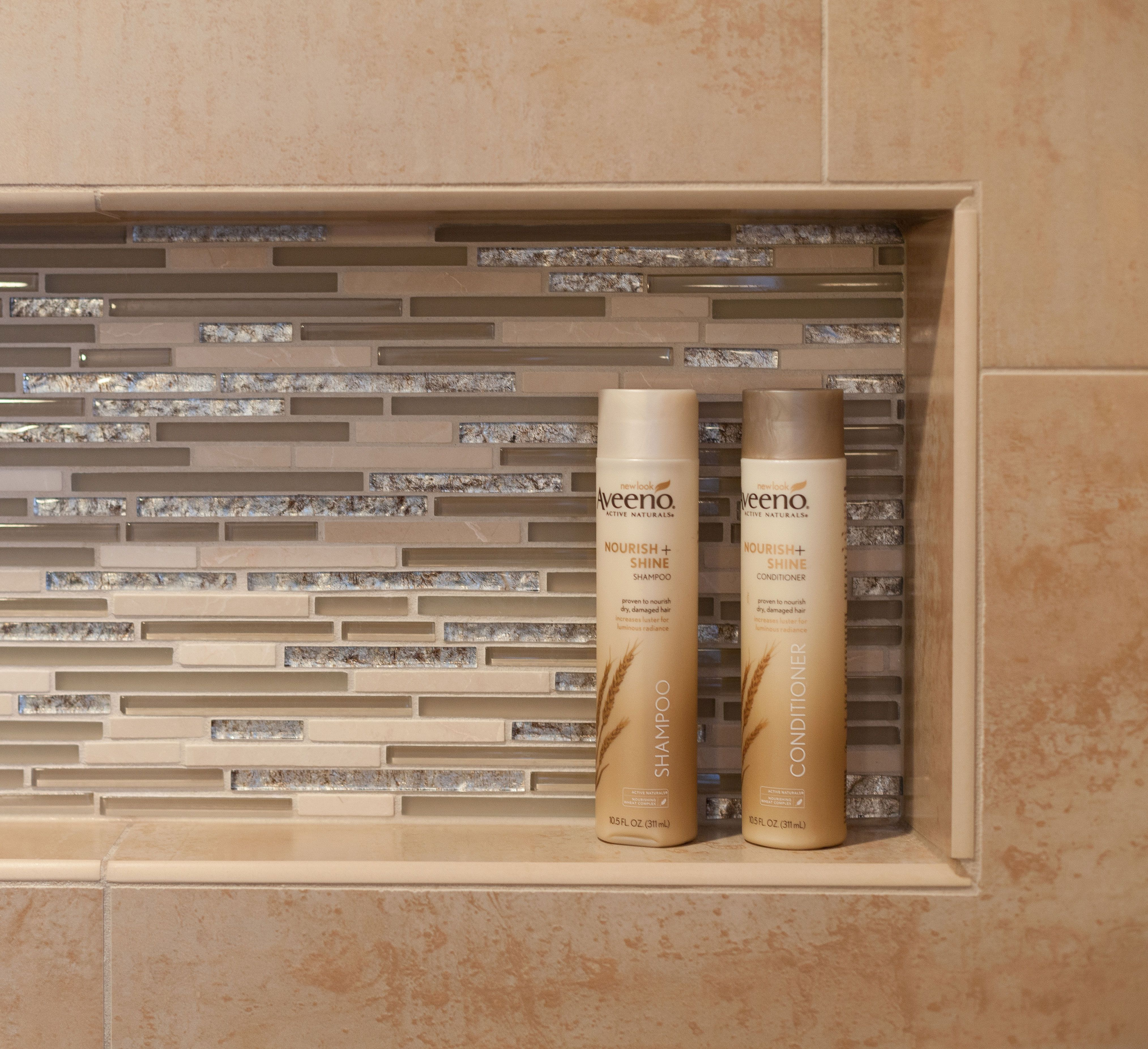 Master Bathroom: Niche is accented by glass mosaic tile with a ...