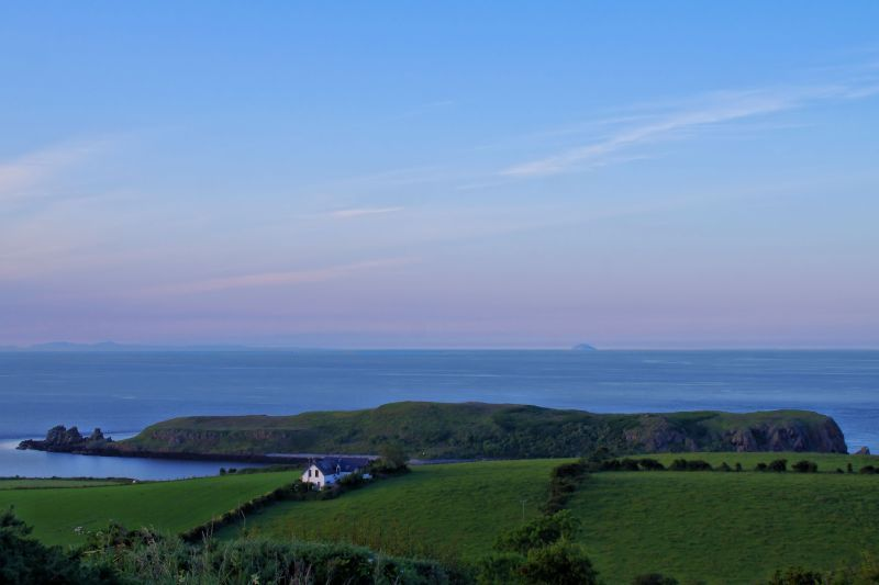 Muck Island in the foreground and the Ailsa Craig, Scotland in the distance - 01.07.2014