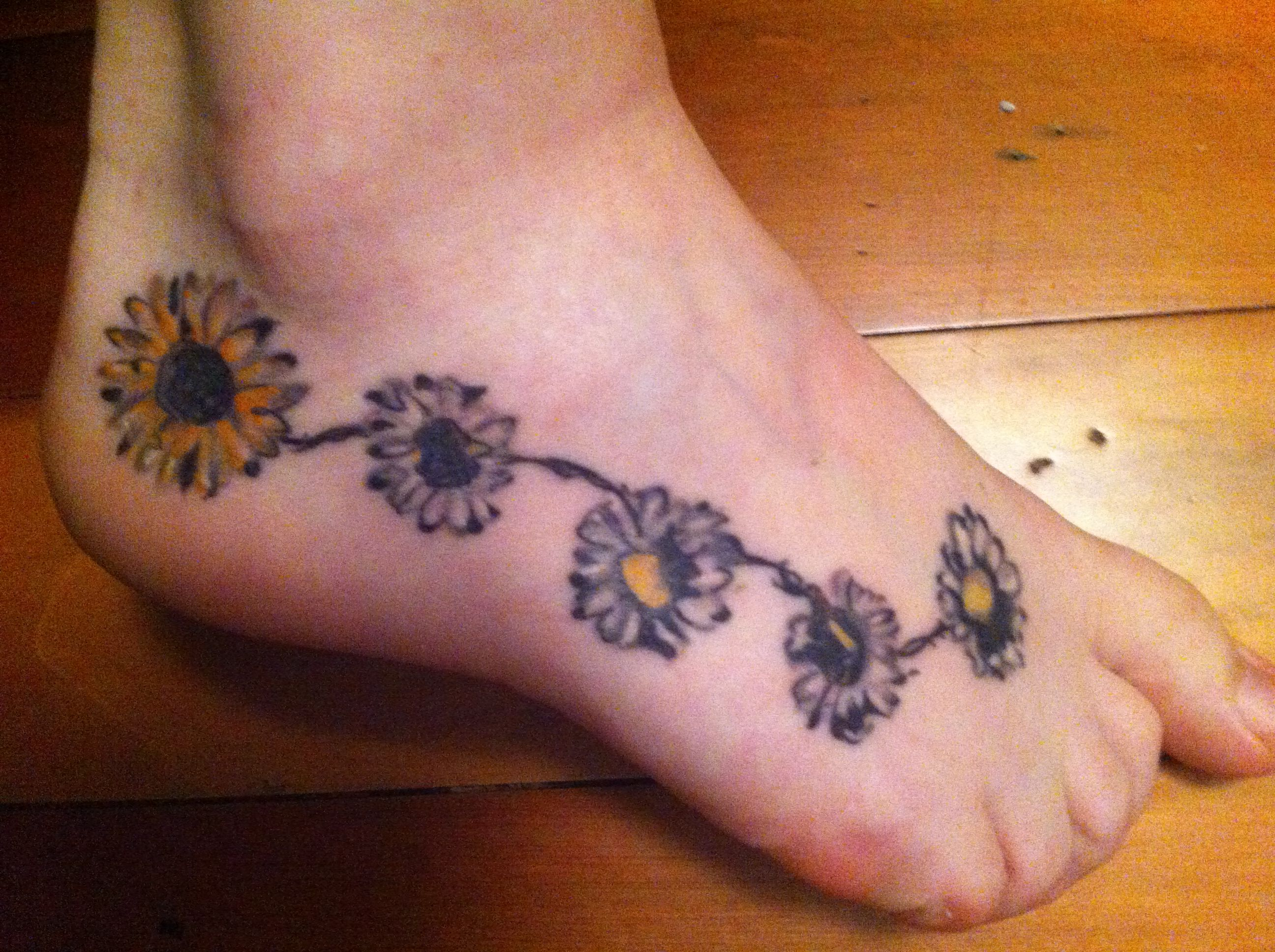 Daisy chain and sunflower tattoo Flower tattoo foot