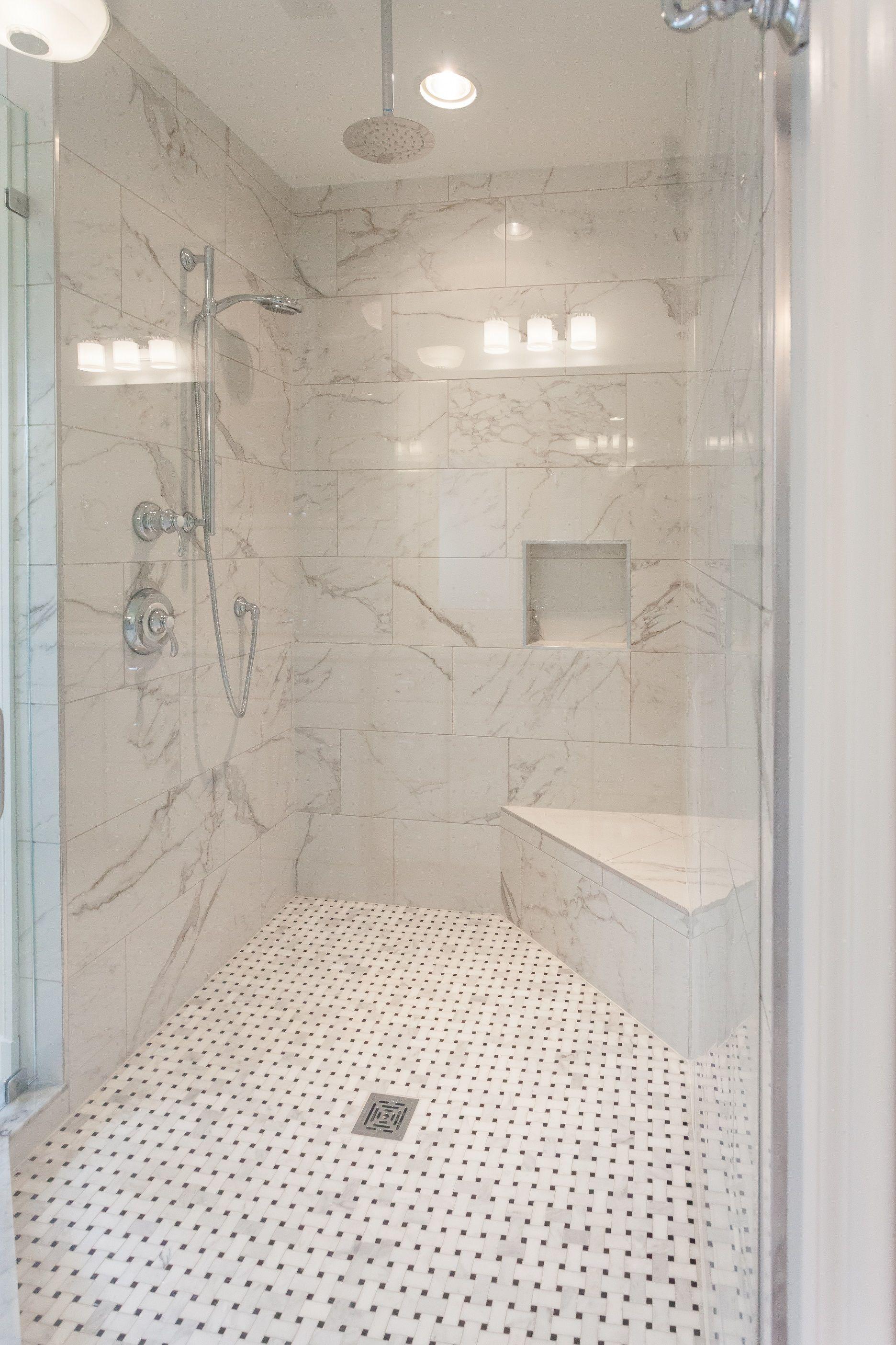 Walk In Shower With Built In Corner Shower Seat And Basketweave Floor Tile In Master Bathroom Of Cust Bathroom Remodel Designs Shower Floor Tile Small Bathroom