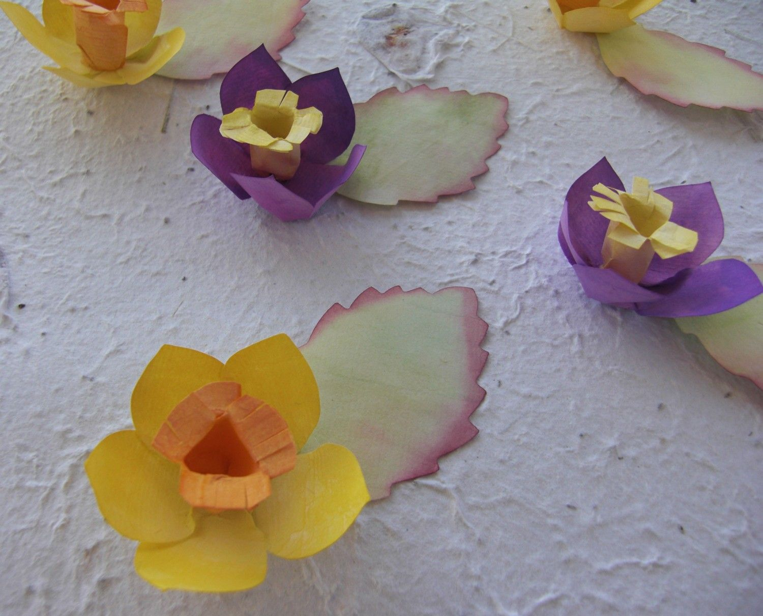 Daffodil Place Cards (25) - wedding place cards, paper flowers, wedding place card holder alternative. $50.00, via Etsy.