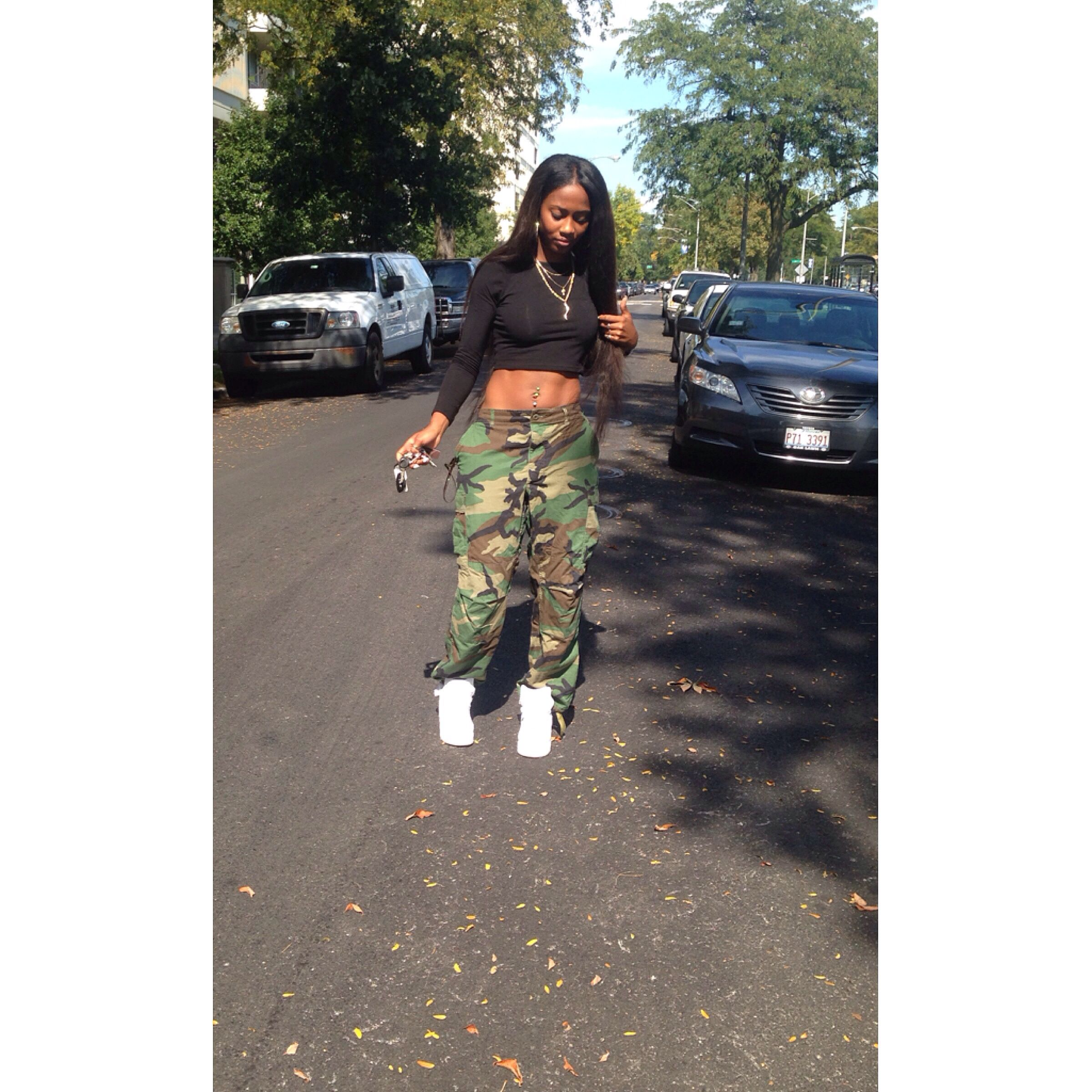 cocainetee in her army pants and high top Air Force 1's