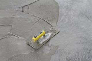 How to pour a leveling layer of concrete over the existing uneven how to pour a leveling layer of concrete over the existing uneven old concrete floor ehow solutioingenieria Choice Image