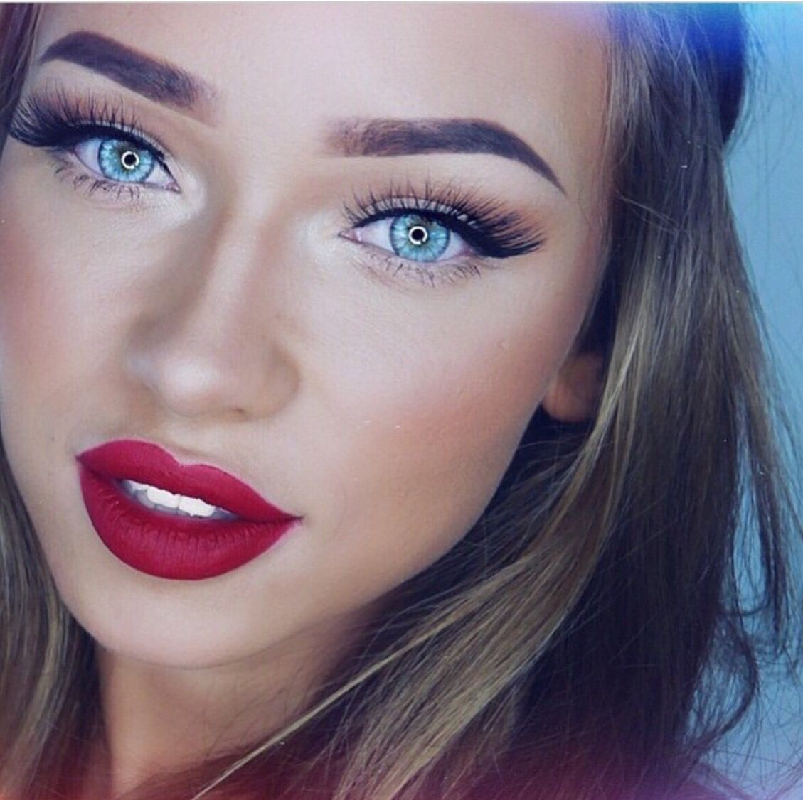 Red lipstick, best with bright blue eyes makeup