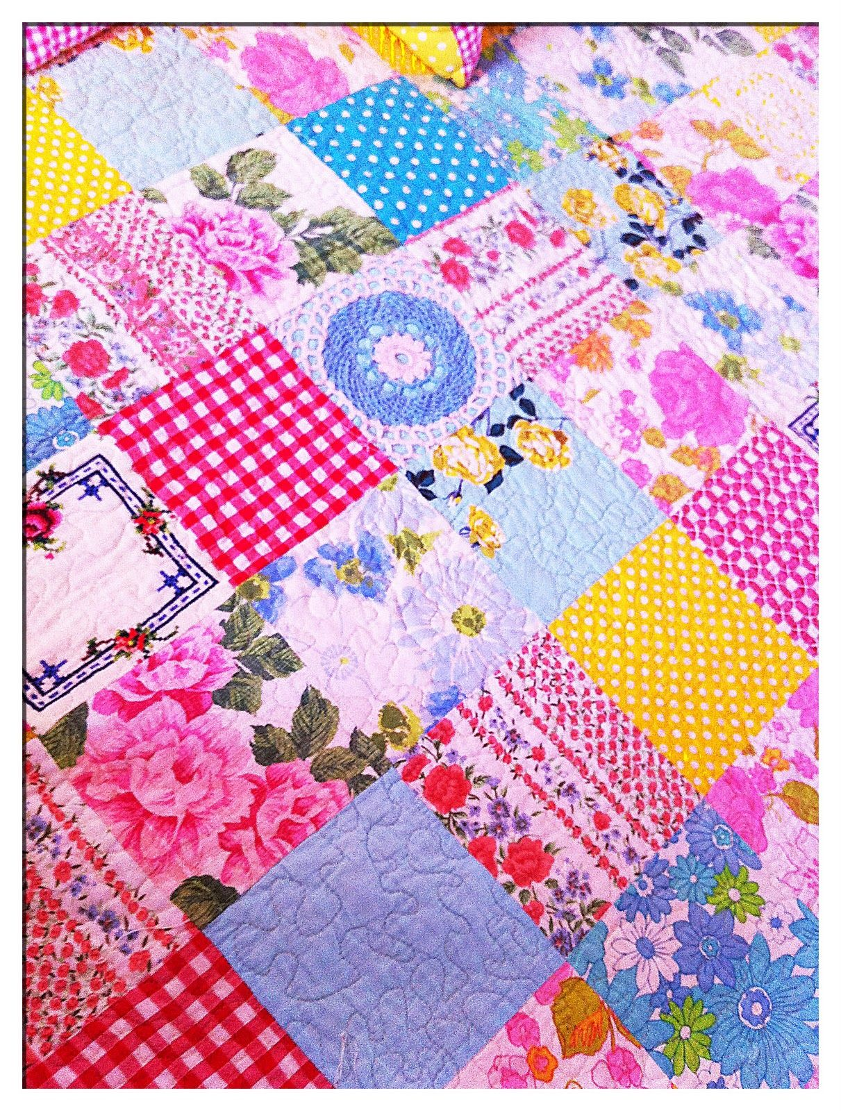 Quilt made from vintage sheets, tablecloths, doilies