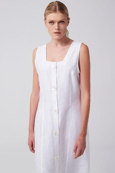 #EcoFriendly #SmallScaleProduction #MadeInTurkey  Crafted with strong, sustainable linen, the simple elegance of this classic white frock makes it incredibly easy to style. Wide straps and a mid-calf length create a soft, demure look, while maxi seashell buttons down the front are a pretty and playful touch. Casual, comfortable linen is durable and stays cool and dry to the touch despite humidity. We love the slightly 90s vibe.  Details:  100% linen   Made in Turkey