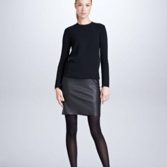 """Black leather Ralph Lauren skirt Size 8 black leather skirt. Slit down the back. There is an issue with the lining  as shown in picture. There is also a tiny pin point on black but I tried  to take a picture but it won't even show.  Skirt is approx 21"""" in length Ralph Lauren Skirts"""