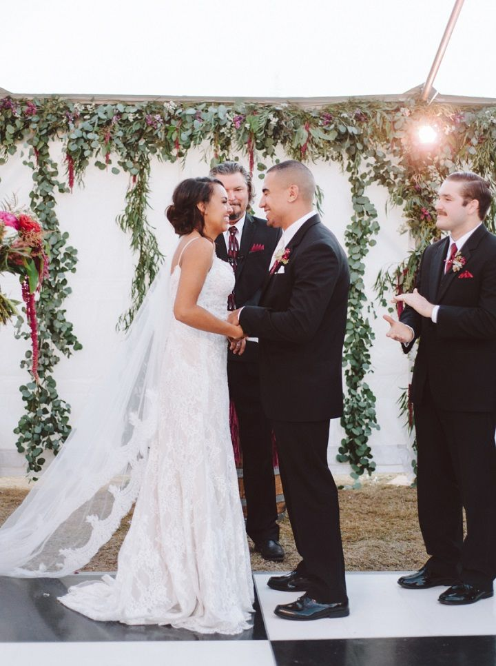 Wedding Ceremony with greenery backdrop | Fall backyard wedding with burgundy details | fabmood.com #wedding #fallwedding #chandelier
