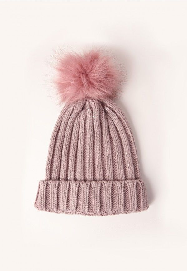 c3babf75359 Get your knit fix in this mauve beanie hat - featuring a dusky pink pom pom  with metallic fibres.