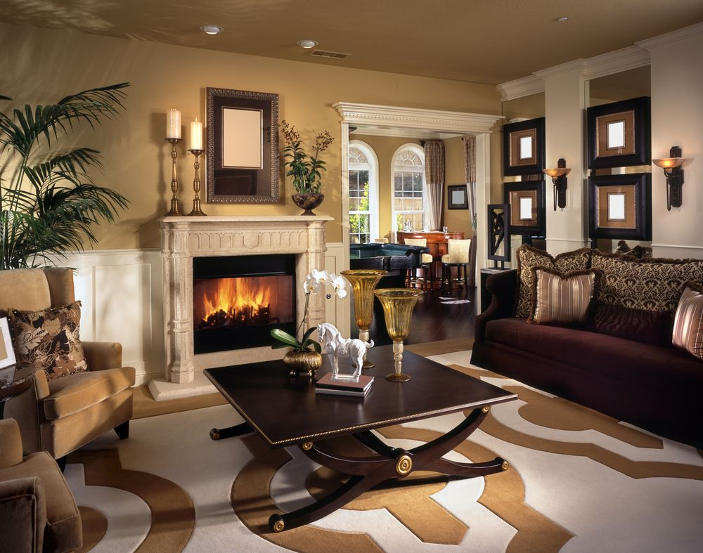 Great attention to detail in this living room design with ornate fireplace white and beige walls brown furniture on rug