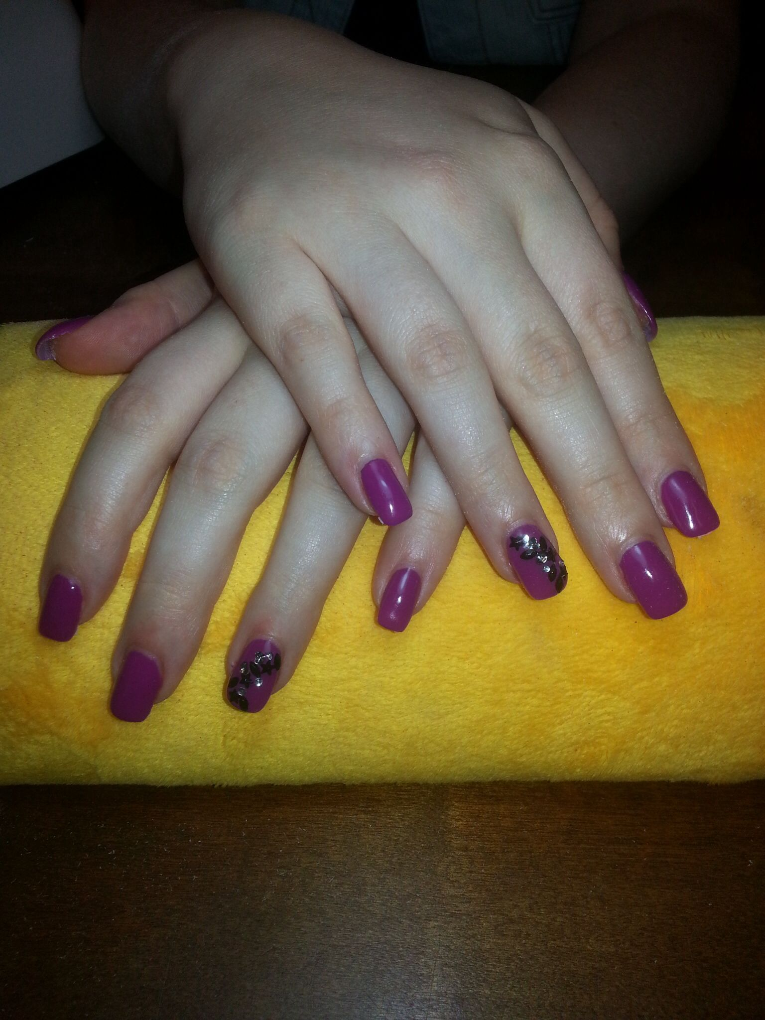 Purple gel nails, with a little creation.