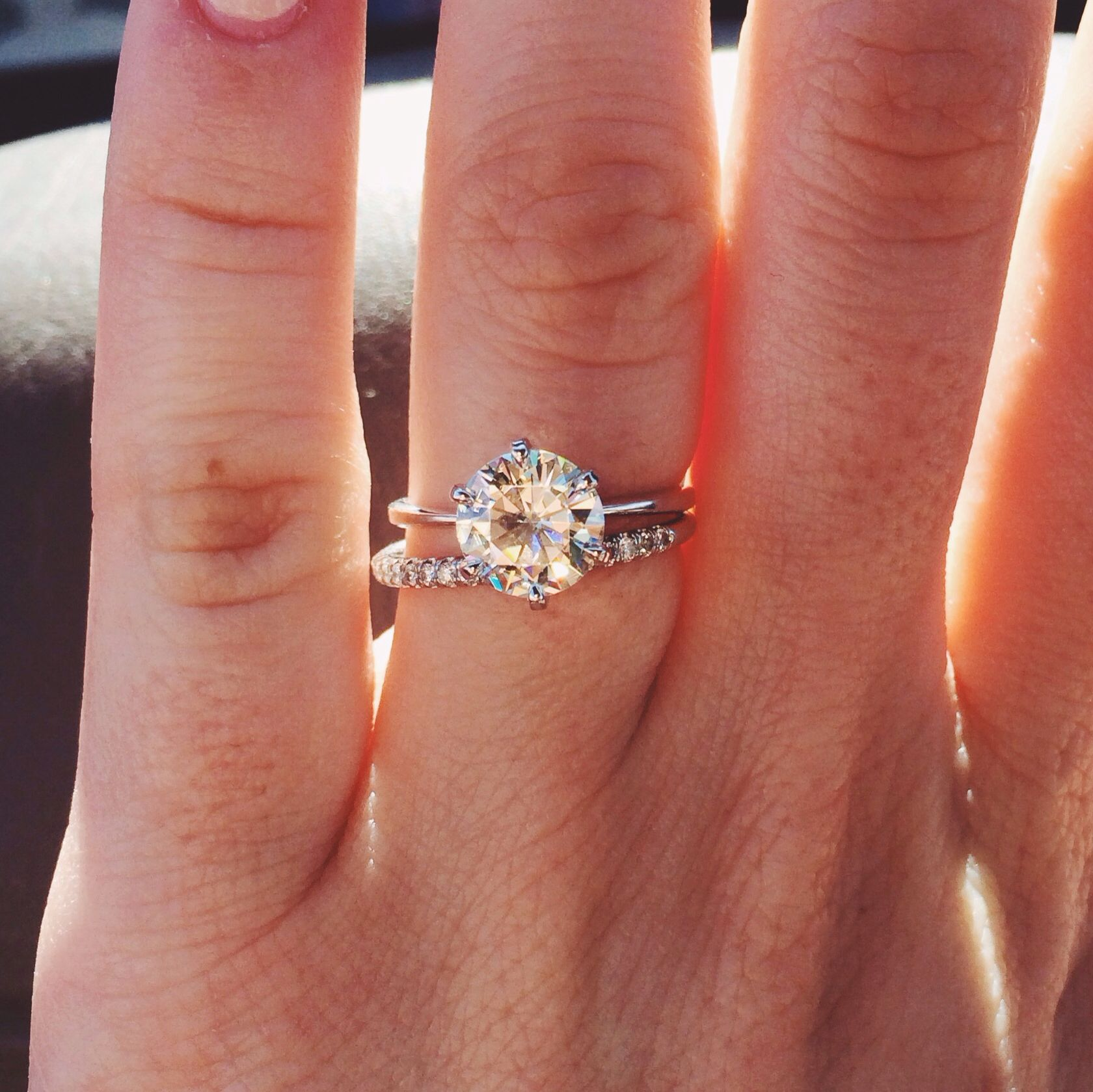Wedding band that goes around engagement ring