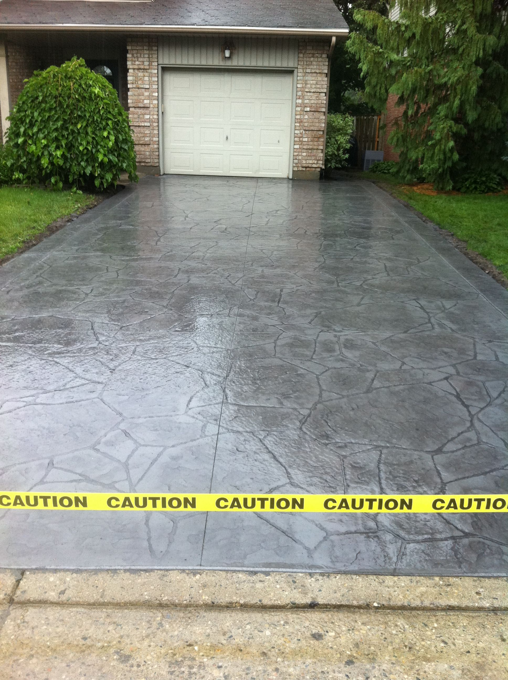 Arizona flagstone stamped concrete driveway with rough cut for Cement driveway ideas