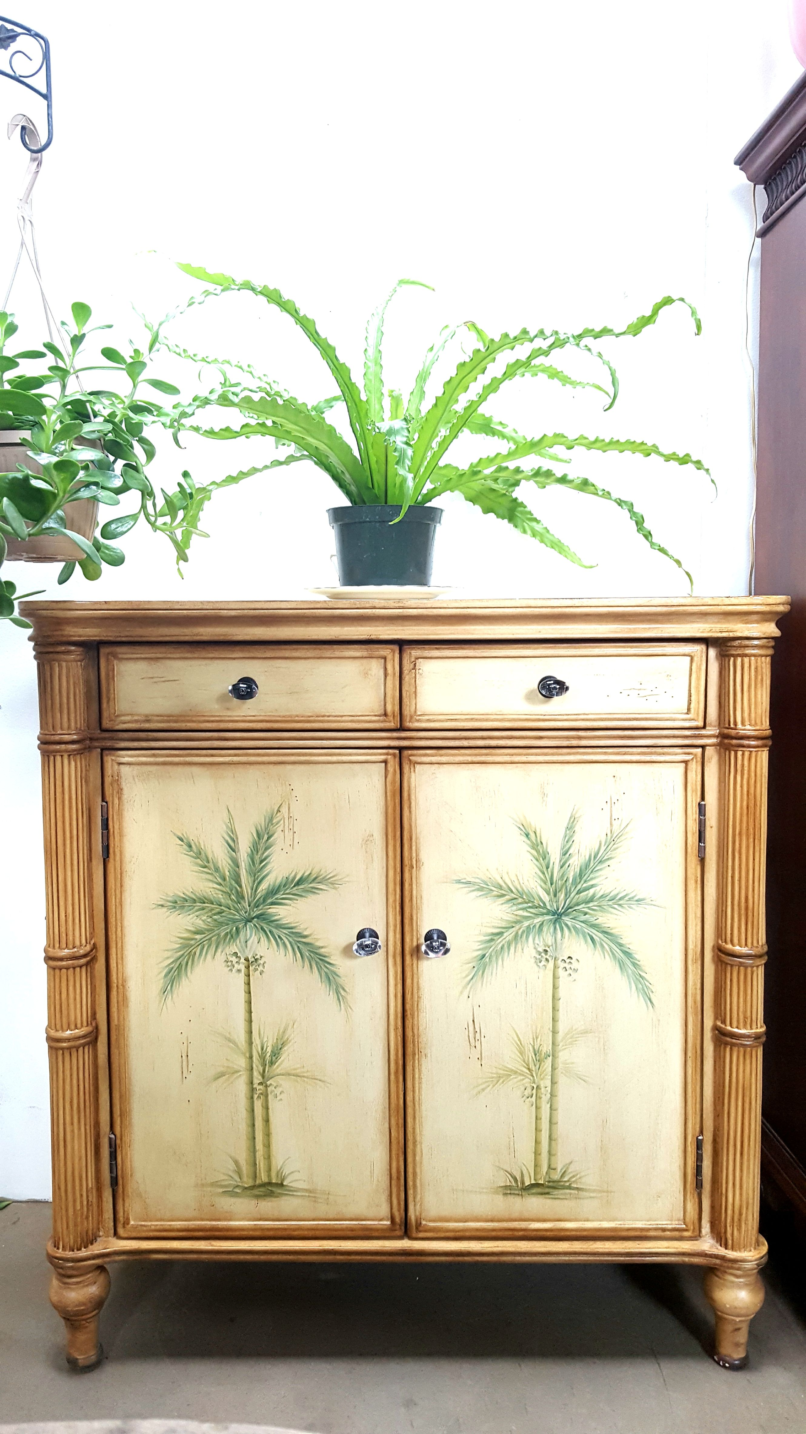Ay Style Cabinet Featuring Bamboo Reminiscent Edges And Palm Trees Painted On The Doors Comes With Two Drawers Shelves Inside