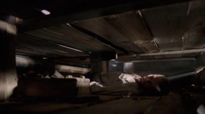 Muukalainen (2008) movie by J-P. Valkeapää - Boy under a floor boards / ceiling not looking