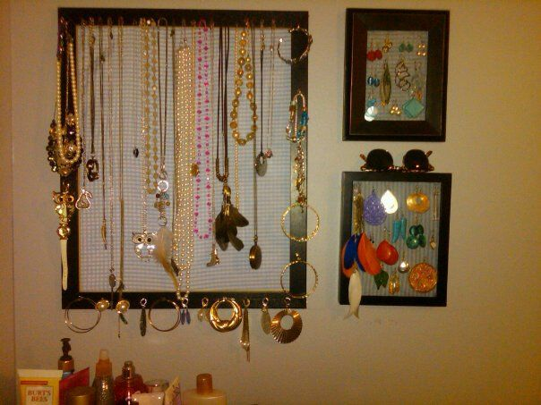 Just hung my jewelry in frames. Screen stapled to the back of the frames for the earrings, fabric stapled behind that. Nails and hooks attached to the front, then all hung from a wire on the wall. Saves tons of counter space, easy to see and pick, and looks great!