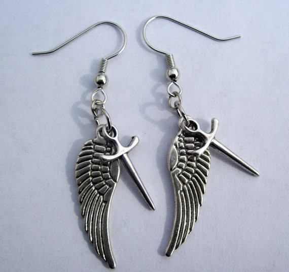 This is a pair of Castiel earrings. Inspired by the T.V. show Supernatural. They include Castiel's Angel wings and his Angel Blade. Made with Tibetan silver wings and blade. Perfect for anyone who lov
