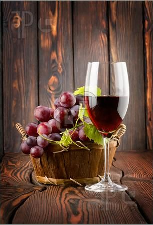 Wine glass and grapes in a basket still-life