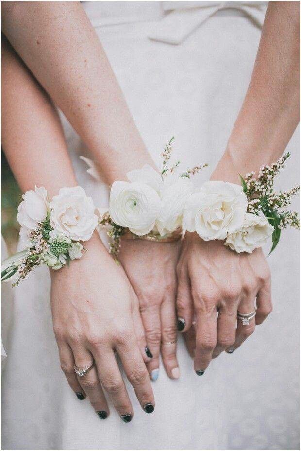The mothers will wear ivory spray roses and jasmine vine on a silver bracelet.