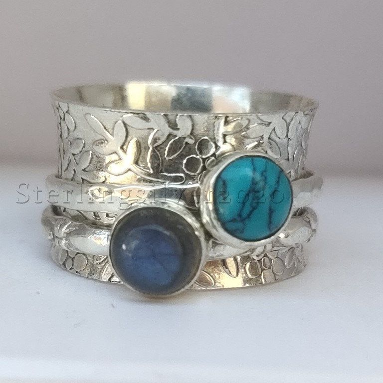 A multi stone spinner ring.